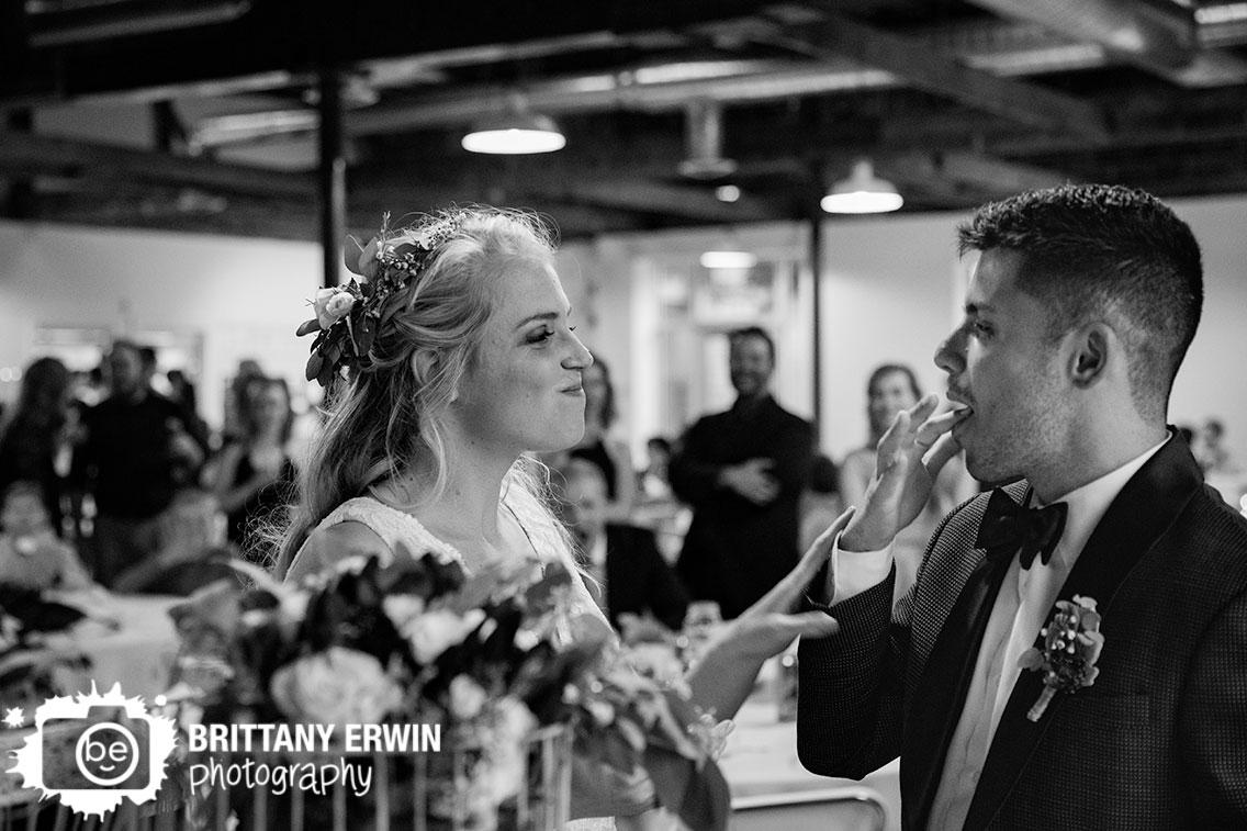 Fountain-Square-Indiana-wedding-photographer-cake-cutting-bride-groom-smile.jpg