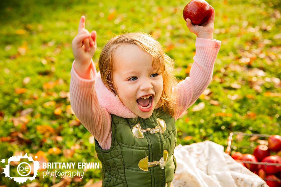 Indianapolis-fall-portrait-photographer-apple-silly-girl-toddler-outside.jpg