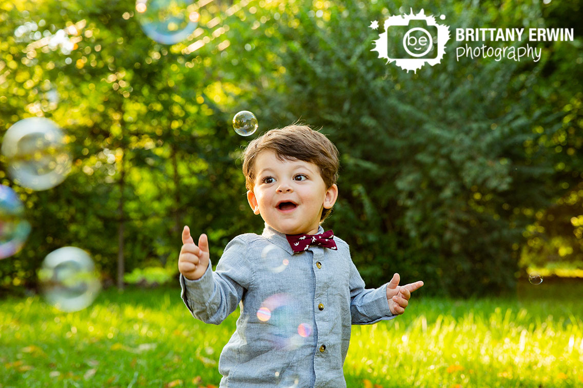 Indianapolis-fall-portrait-photographer-toddler-boy-outside-playing-with-bubbles.jpg