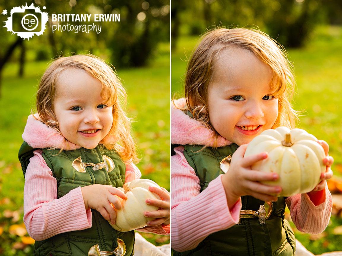 Indianapolis-fall-portrait-photographer-vest-pumpkin-toddler-girl-outdoor.jpg