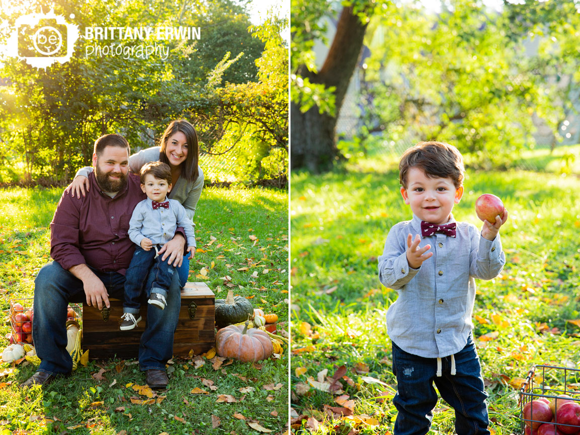 Indianapolis-fall-mini-session-photographer-family-portrait-outside-leaves-with-apples.jpg