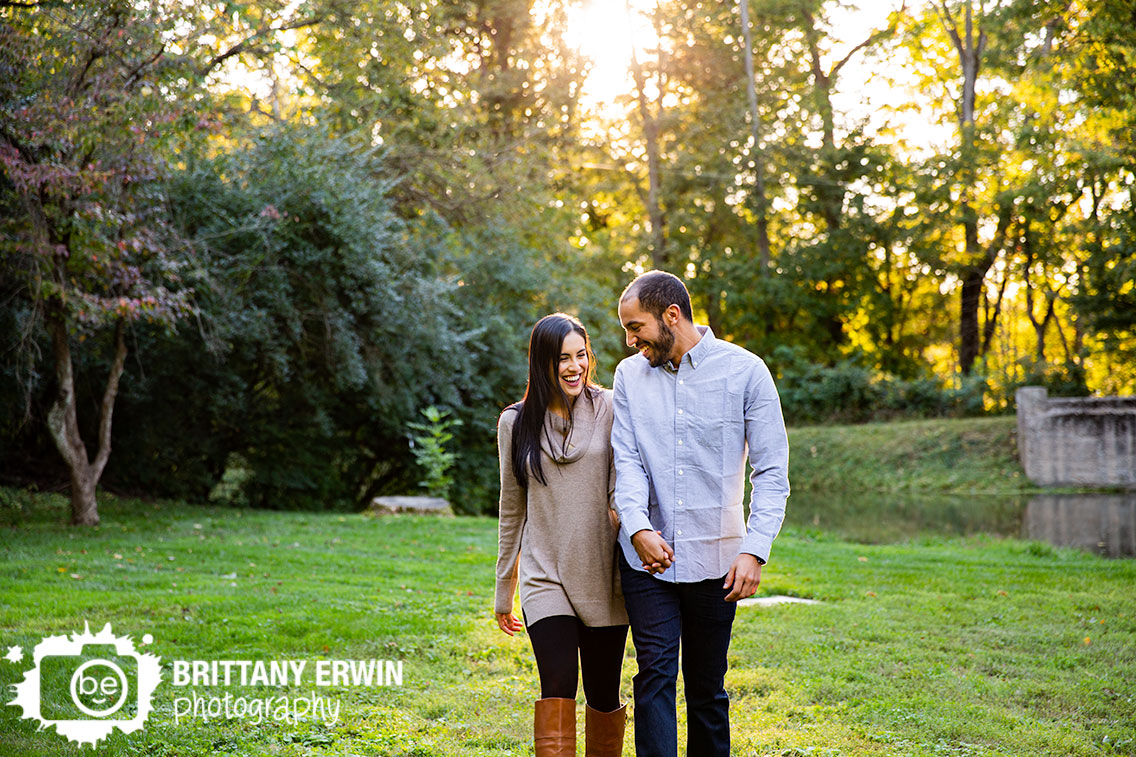 Holcomb-Gardens-couple-engagement-portrait-photographer-walking-at-sunset.jpg