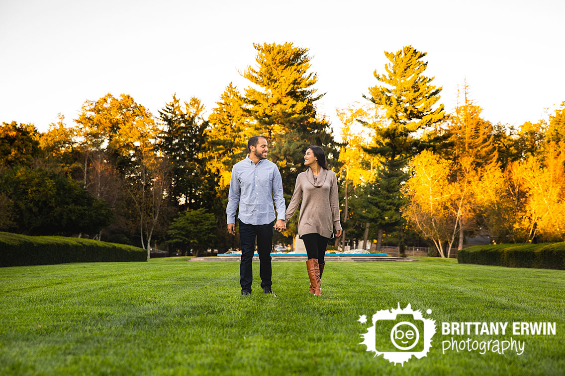 Autumn-leaves-outdoor-engagement-portrait-photographer-couple-walking.jpg