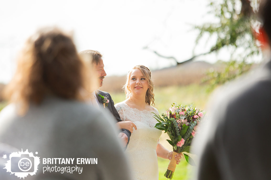 Wea-Creek-Orchard-wedding-ceremony-photographer-bride-walking-down-aisle-with-father.jpg