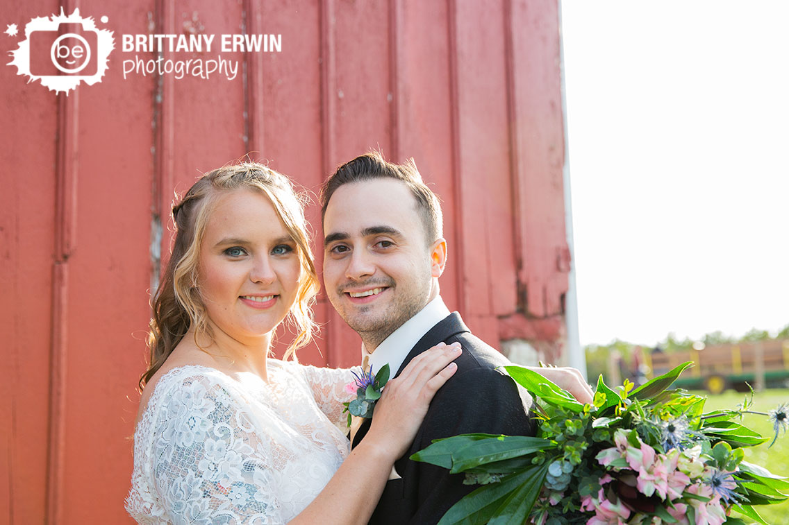 Wea-Creek-Orchard-bridal-portrait-couple-outside-red-painted-barn-whole-foods-florist-bouquet.jpg