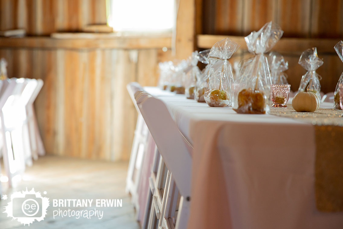 wea-creek-orchard-wedding-venue-barn-white-folding-chairs-caramel-apple-thank-you-favors.jpg