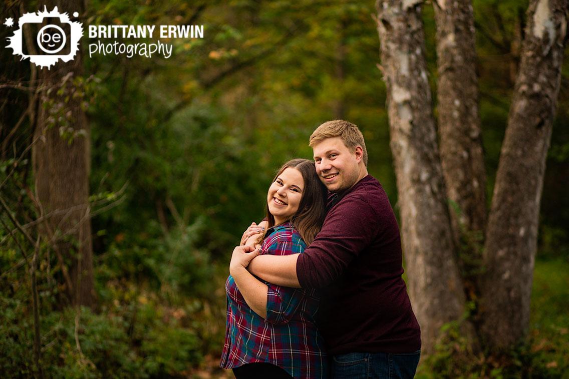 Indianapolis-engagement-photographer-couple-peeling-birch-tree-fun-hug-in-fall.jpg