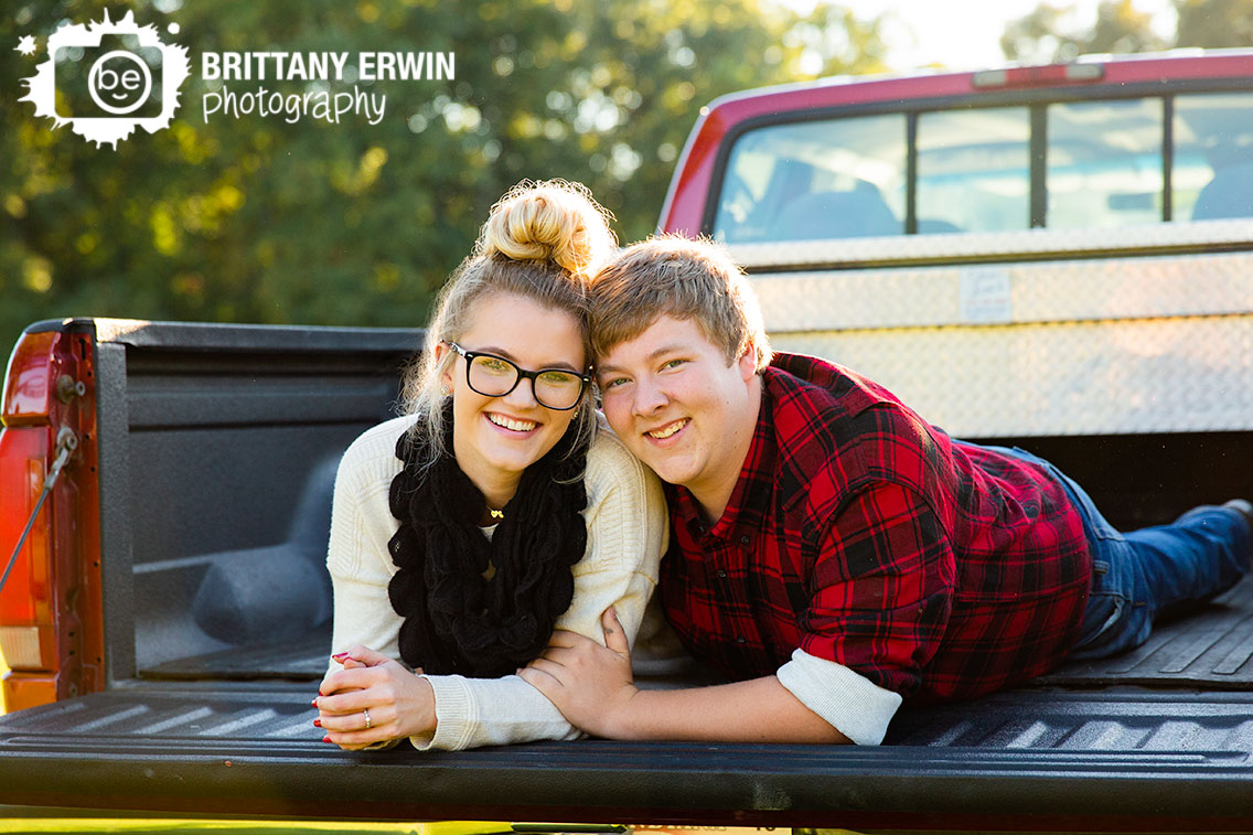 Martinsville-engagement-portrait-couple-in-truck-bed-sunset-fall.jpg
