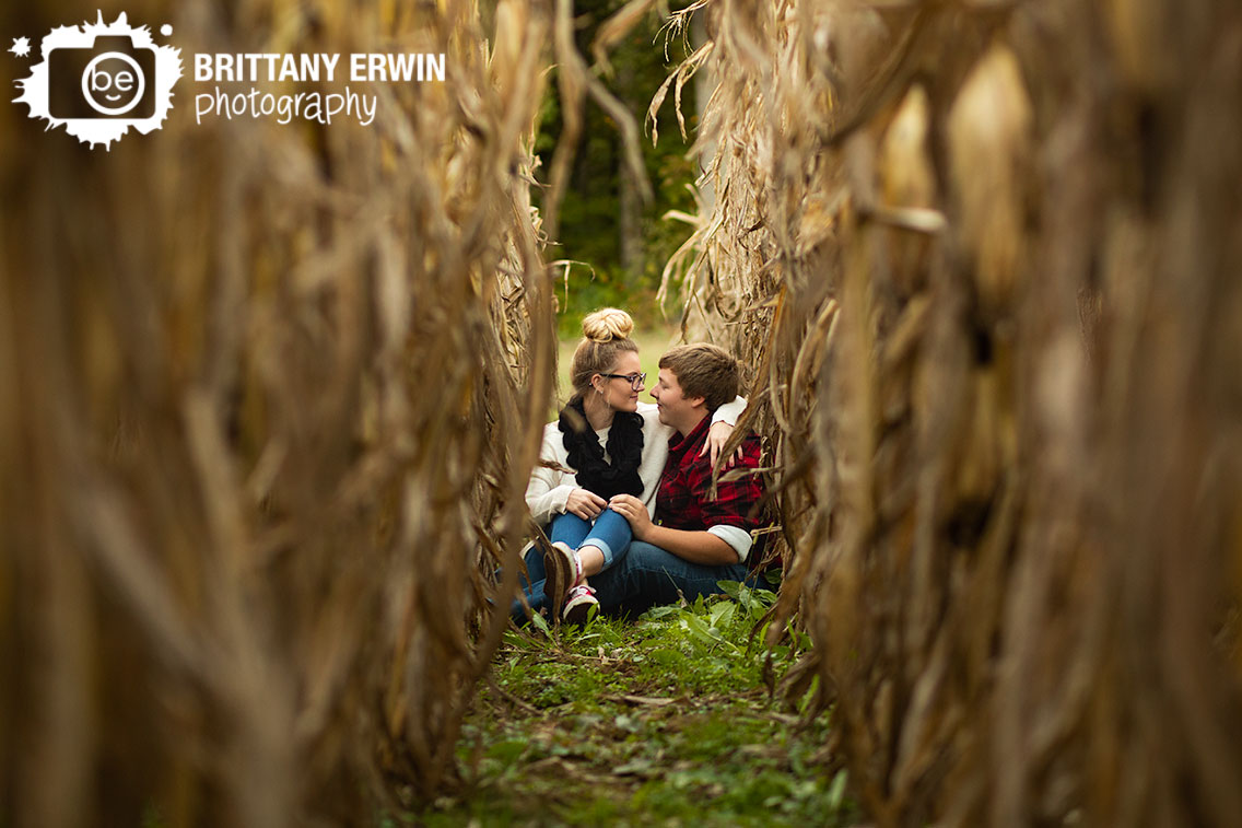 corn-field-indiana-engagement-portraits-outdoor-couple-sitting-in-row.jpg