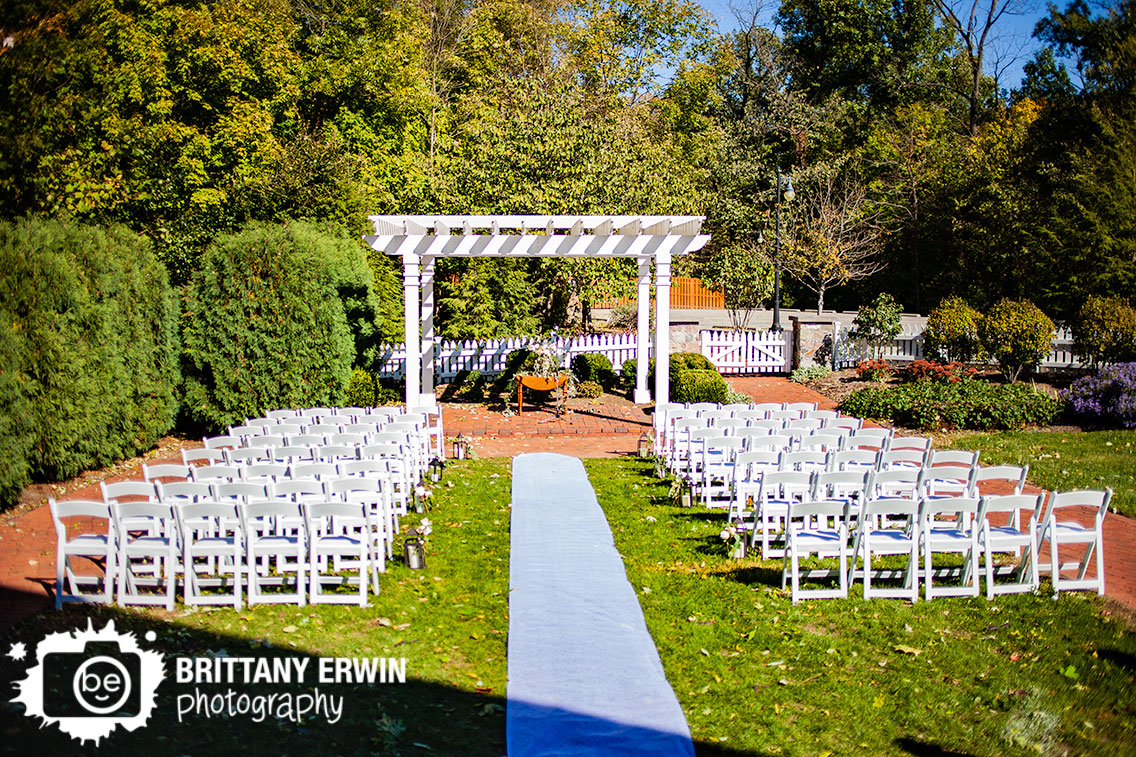 Historic-Ambassador-House-wedding-ceremony-outdoor-fall-with-flower-table-aisle-runner-lantern.jpg