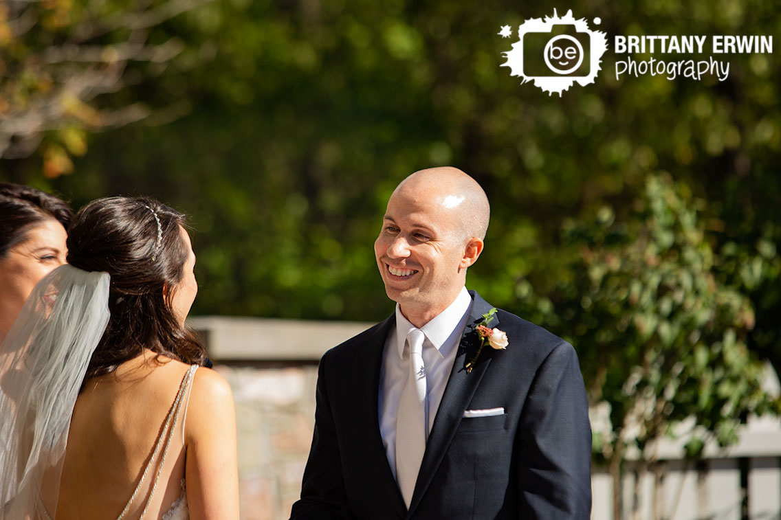 Historic-Ambassador-House-wedding-ceremony-groom-smile-at-bride-altar-couple.jpg