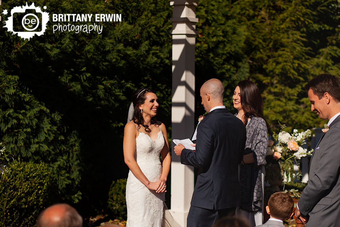 Historic-Ambassador-House-wedding-ceremony-photographer-bride-smile-at-groom-vows.jpg