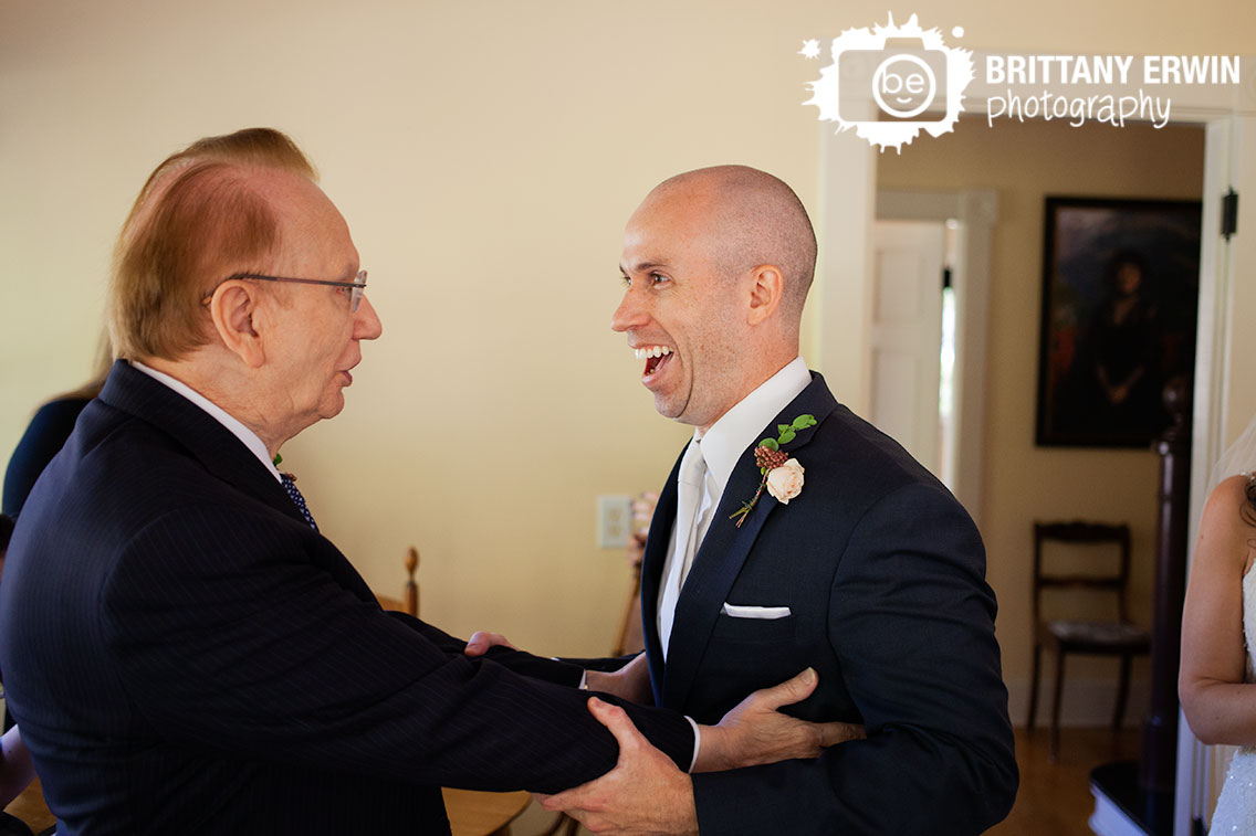 Groom-with-father-of-bride-happy-reaction-Historic-Ambassador-House.jpg