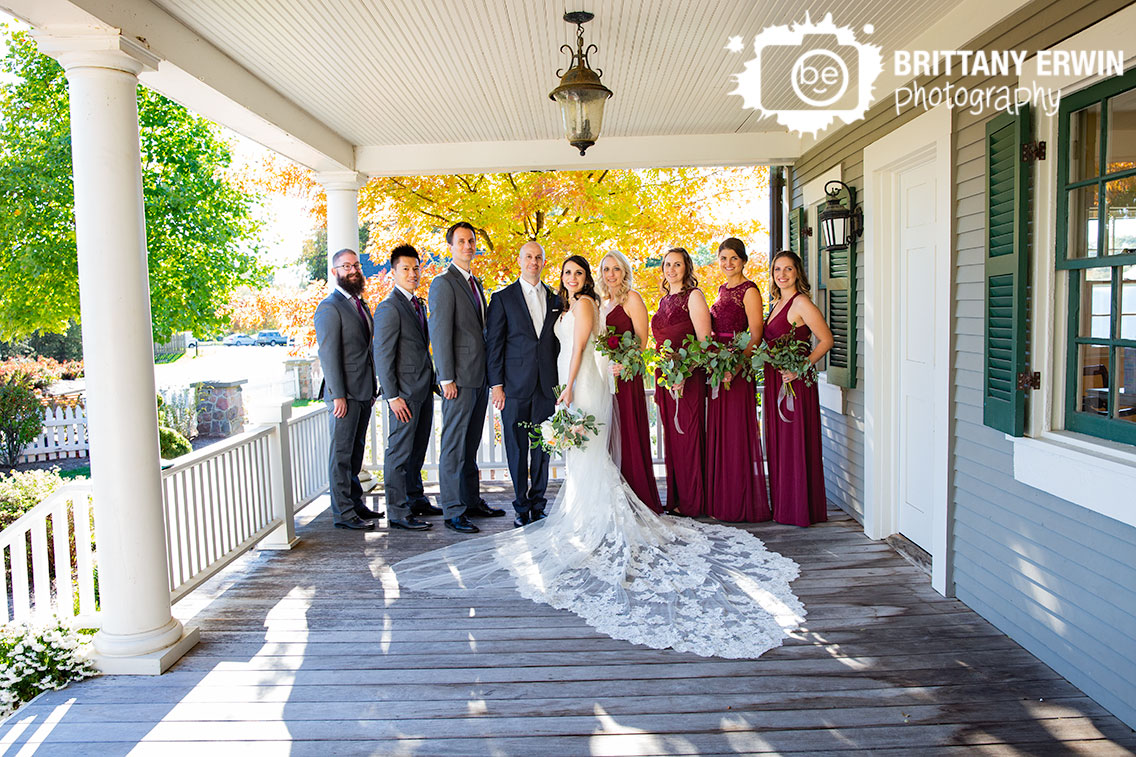Historic-Ambassador-House-porch-bridal-party-portrait-group-bride-groom.jpg
