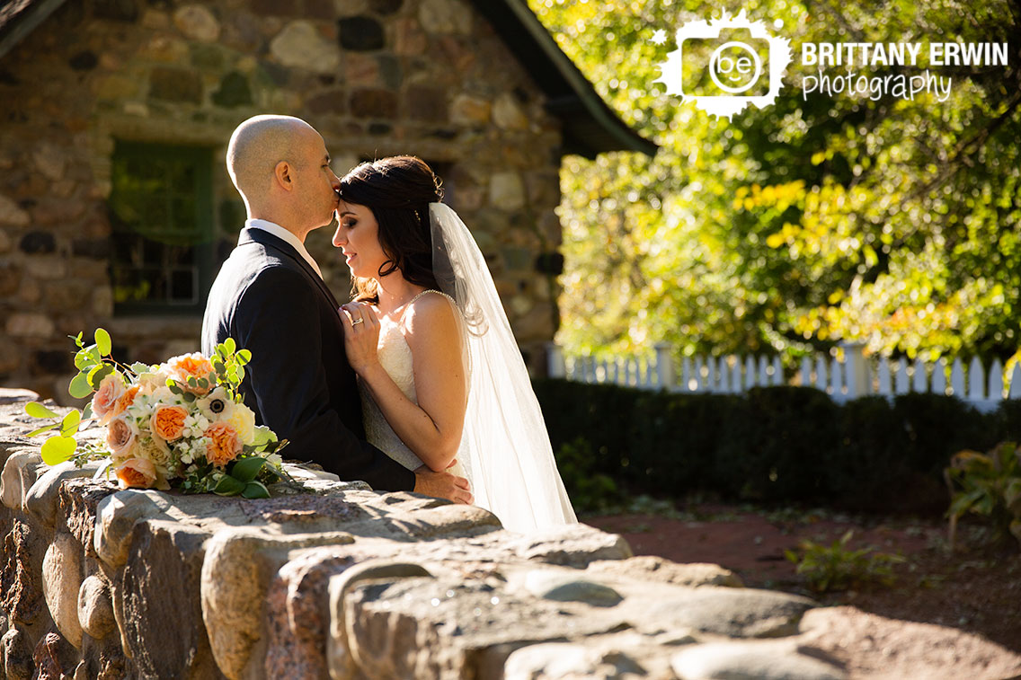 Fishers-Indiana-bridal-portrait-photographer-bride-groom-stone-wall-molly-and-myrtle-bouquet.jpg
