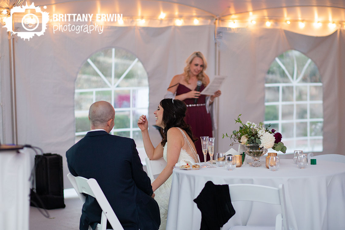 Fishers-Indiana-wedding-photographer-bride-laughing-toast-by-maid-of-honor.jpg