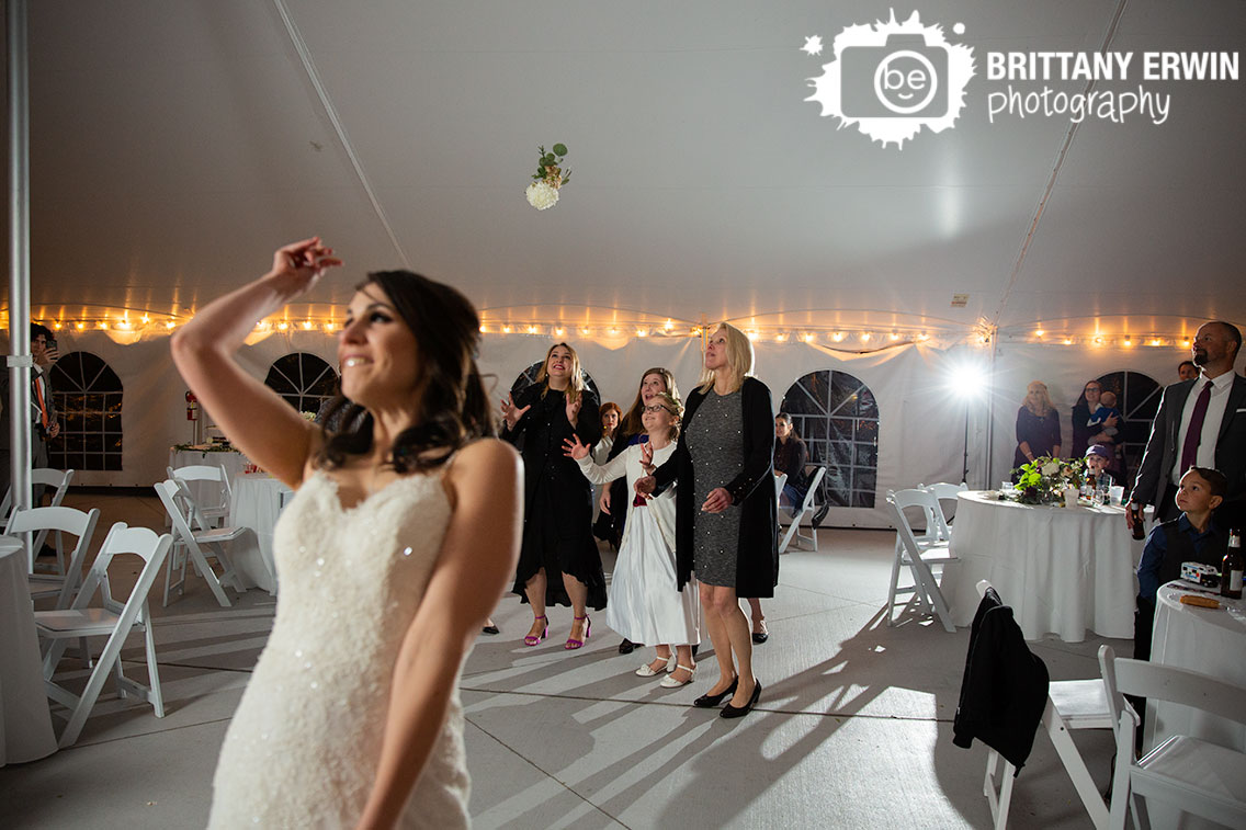 Historic-Ambassador-House-bride-toss-bouquet-reaction.jpg