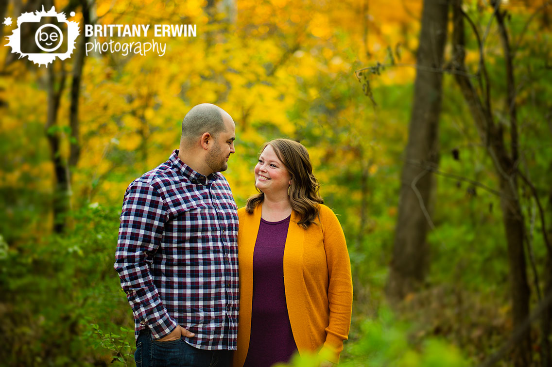 Fall-foliage-yellow-leaves-engagement-portrait-photography-couple-outside-bokeh.jpg