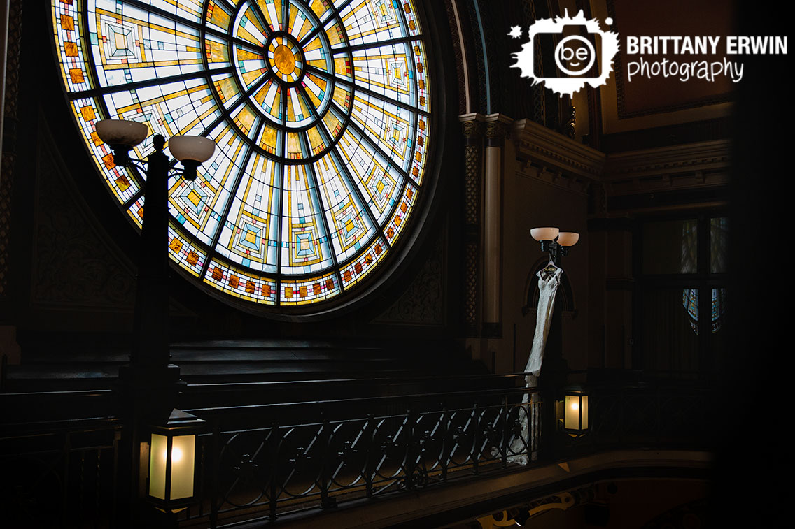 Grand-Union-Station-Indianapolis-stained-glass-window-with-dress-hanging-on-balcony.jpg