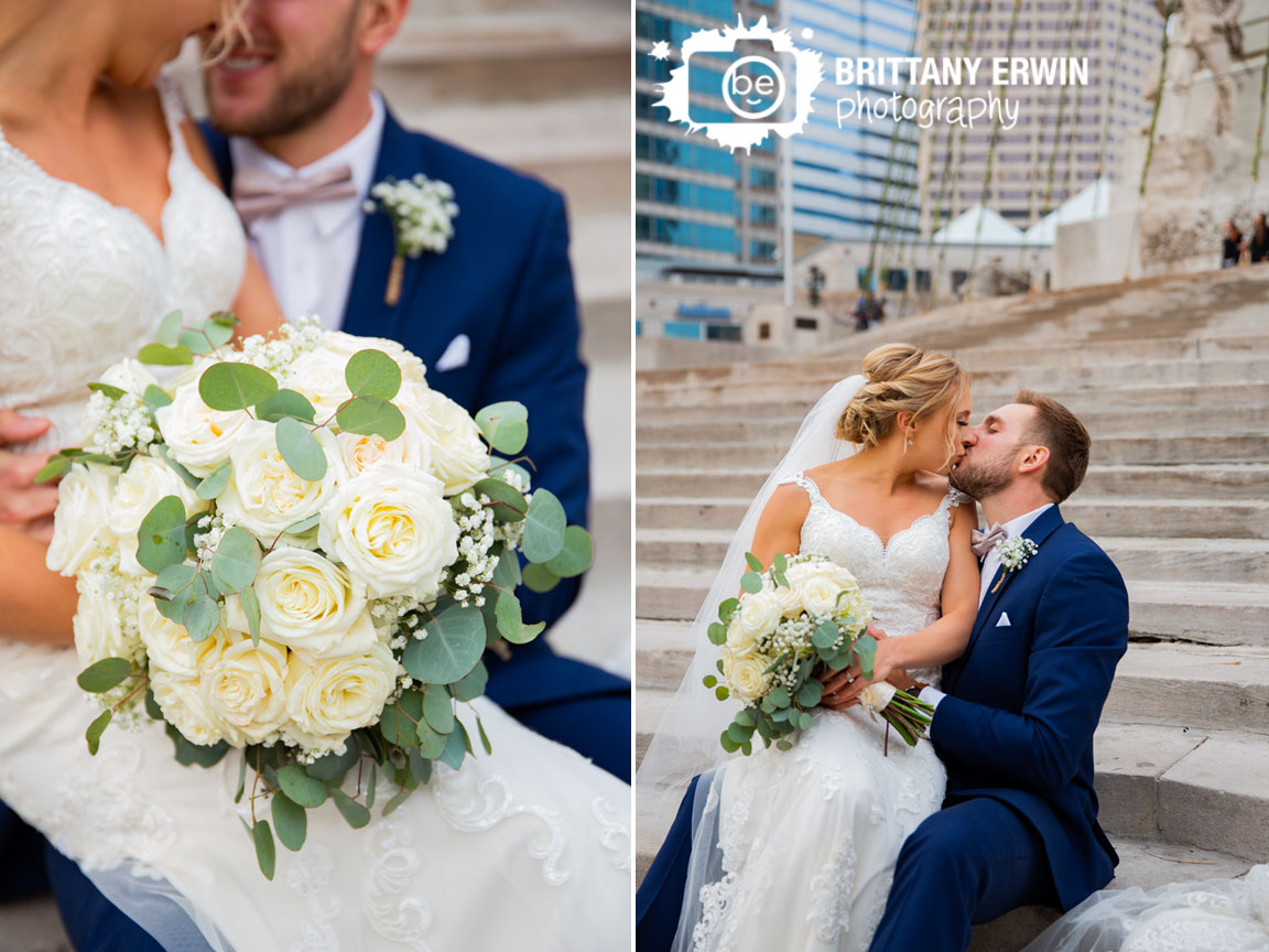 Downtown-Indianapolis-wedding-photographer-couple-on-staircase-white-rose-bouquet-on-monument-circle.jpg