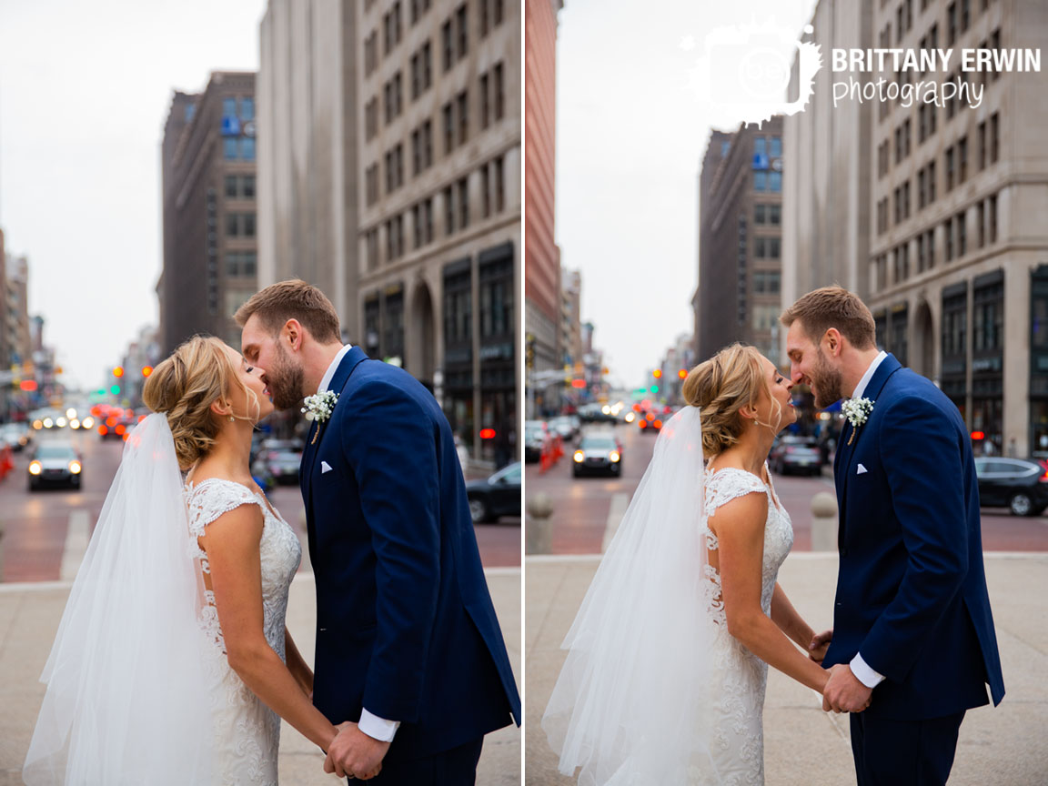 Downtown-Indianapolis-couple-kiss-on-monument-circle-veil.jpg