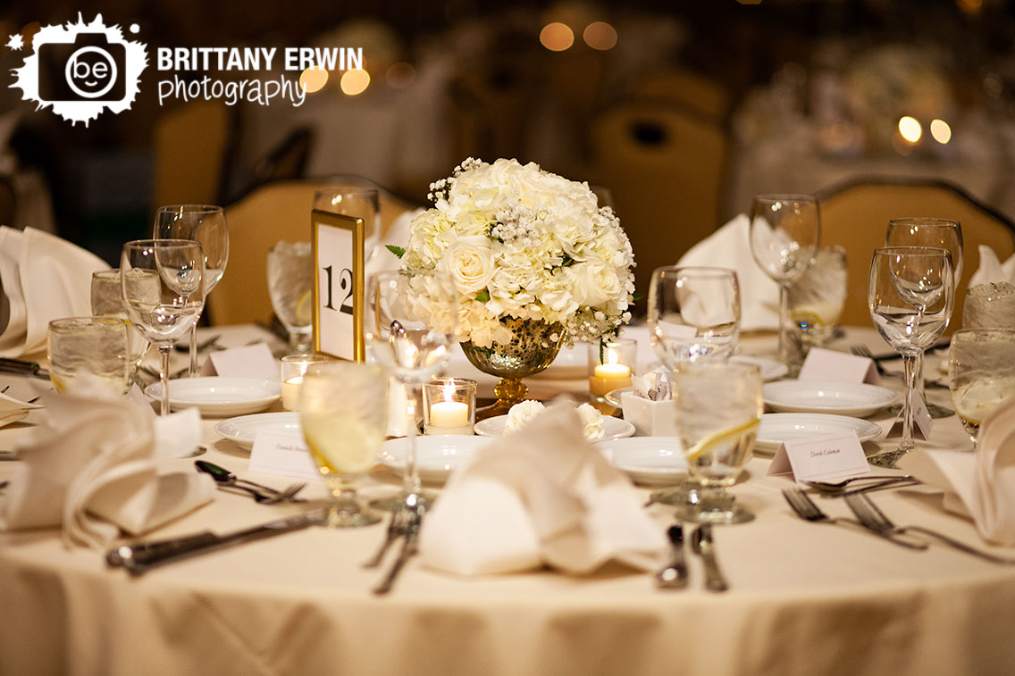 Indianapolis-wedding-reception-photographer-white-flower-floral-centerpiece-with-candles.jpg