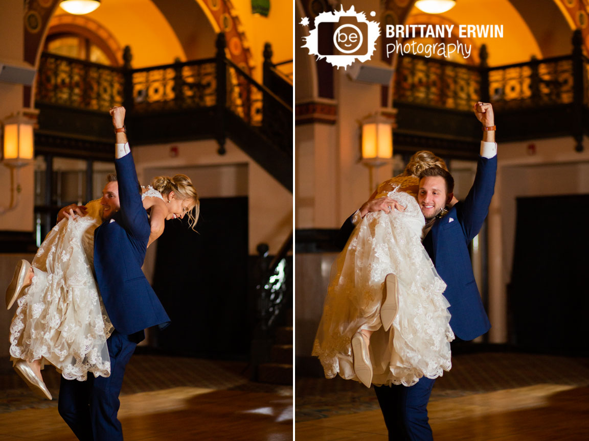 Indianapolis-wedding-photographer-bride-and-groom-announced-in-carrying-over-shoulder.jpg