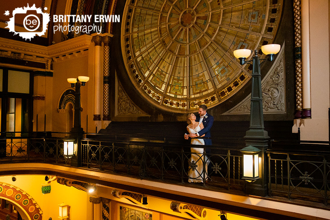 Indianapolis-wedding-photographer-stained-glass-window-couple-on-second-floor-Grand-Union-Station.jpg
