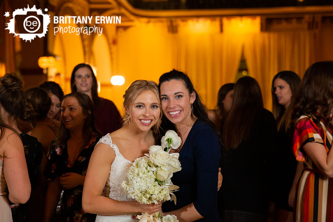 Bride-with-guest-that-caught-bouquet-toss-reception.jpg