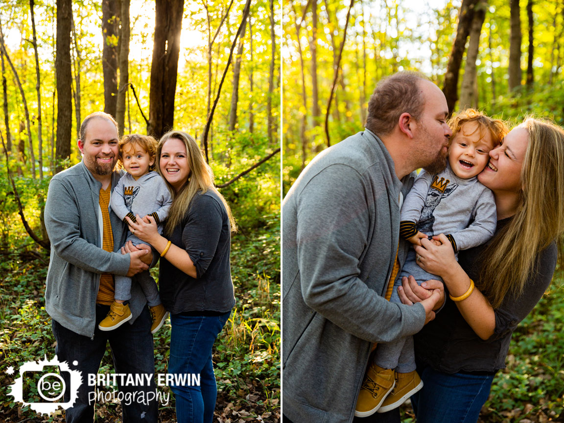 Fall-Indiana-leaves-family-portrait-cheek-kiss-toddler-boy-couple-on-path.jpg