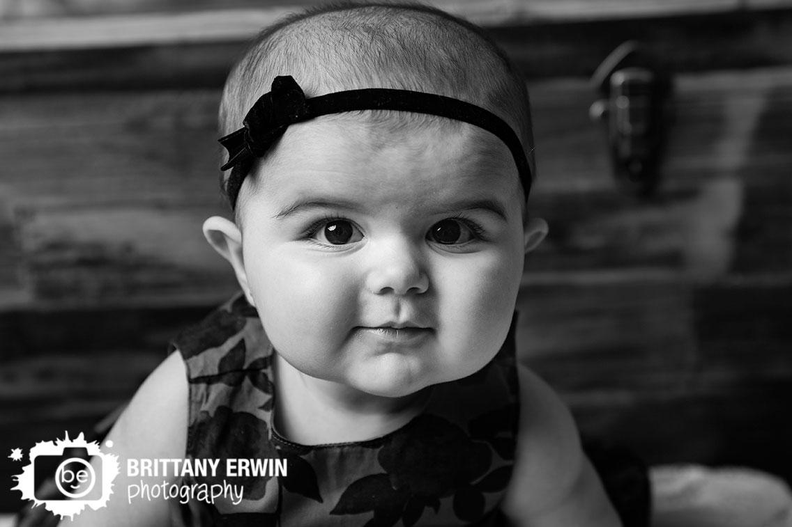 Baby-girl-portrait-headband-with-dress-reclaimed-wood-wall.jpg