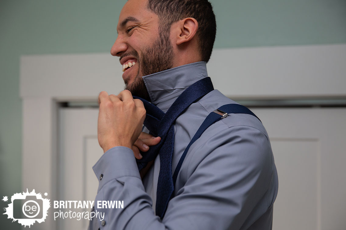 Indianapolis-groom-getting-ready-tying-tie-laughing-elopement.jpg