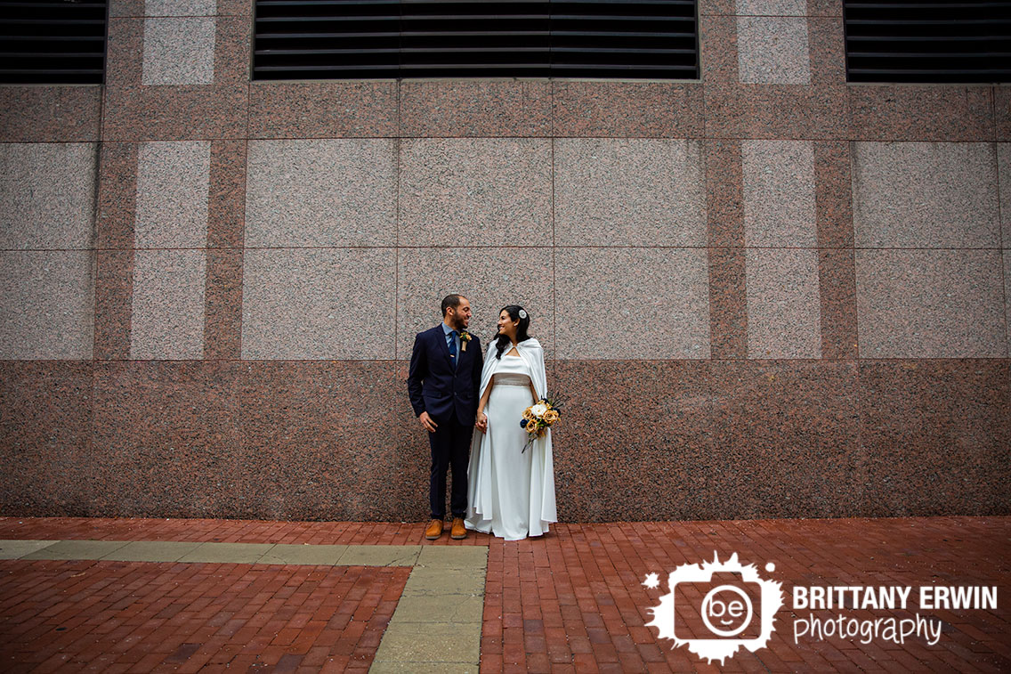Downtown-Indianapolis-granite-wall-stone-couple-elopement-portrait.jpg