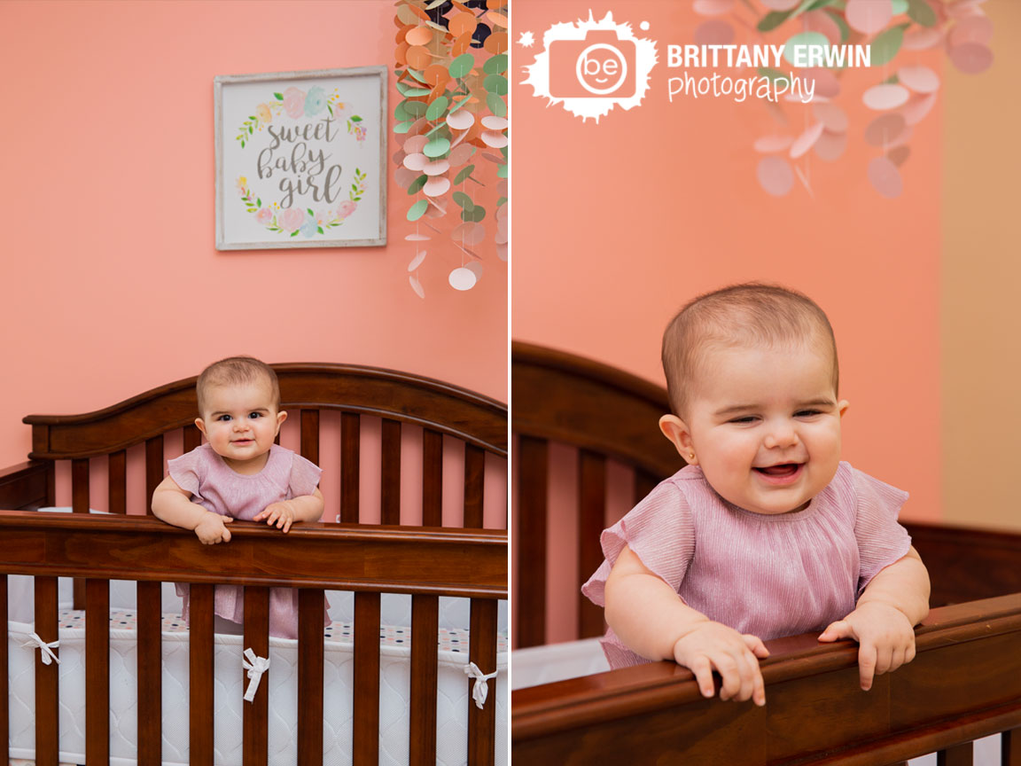 Lifestyle-milestone-photographer-baby-girl-in-crib-paper-mobile-sweet-baby-girl-print.jpg