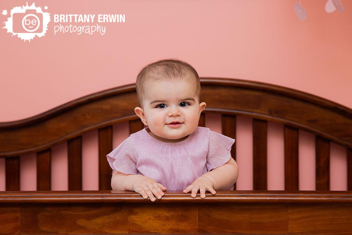 baby-girl-milestone-standing-in-crib-lifstyle-portrait-photographer.jpg