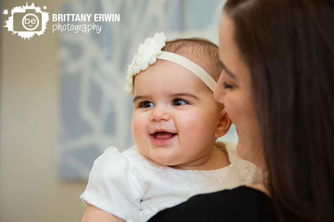 Indianapolis-lifestyle-portrait-photographer-baby-girl-9-months-baptism-gown-smiling-off-camera.jpg