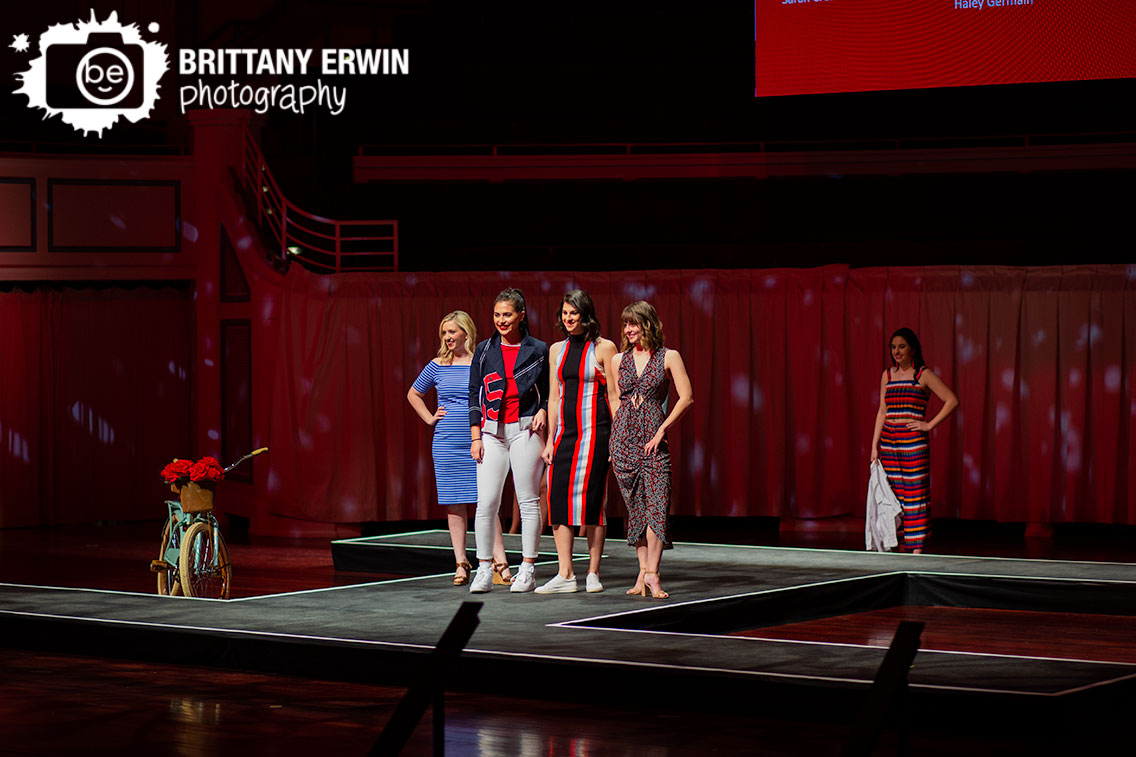 Indianapolis-fashion-show-American-Heart-Association-Go-Red-for-women-luncheon-models-with-bike-red-flowers.jpg