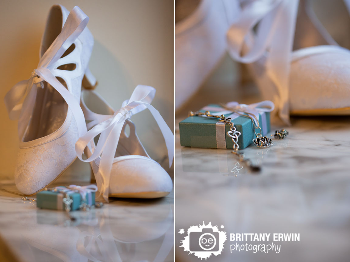 Indianapolis-wedding-photographer-white-lace-shoes-bride-details-earrings-necklace-on-marble.jpg