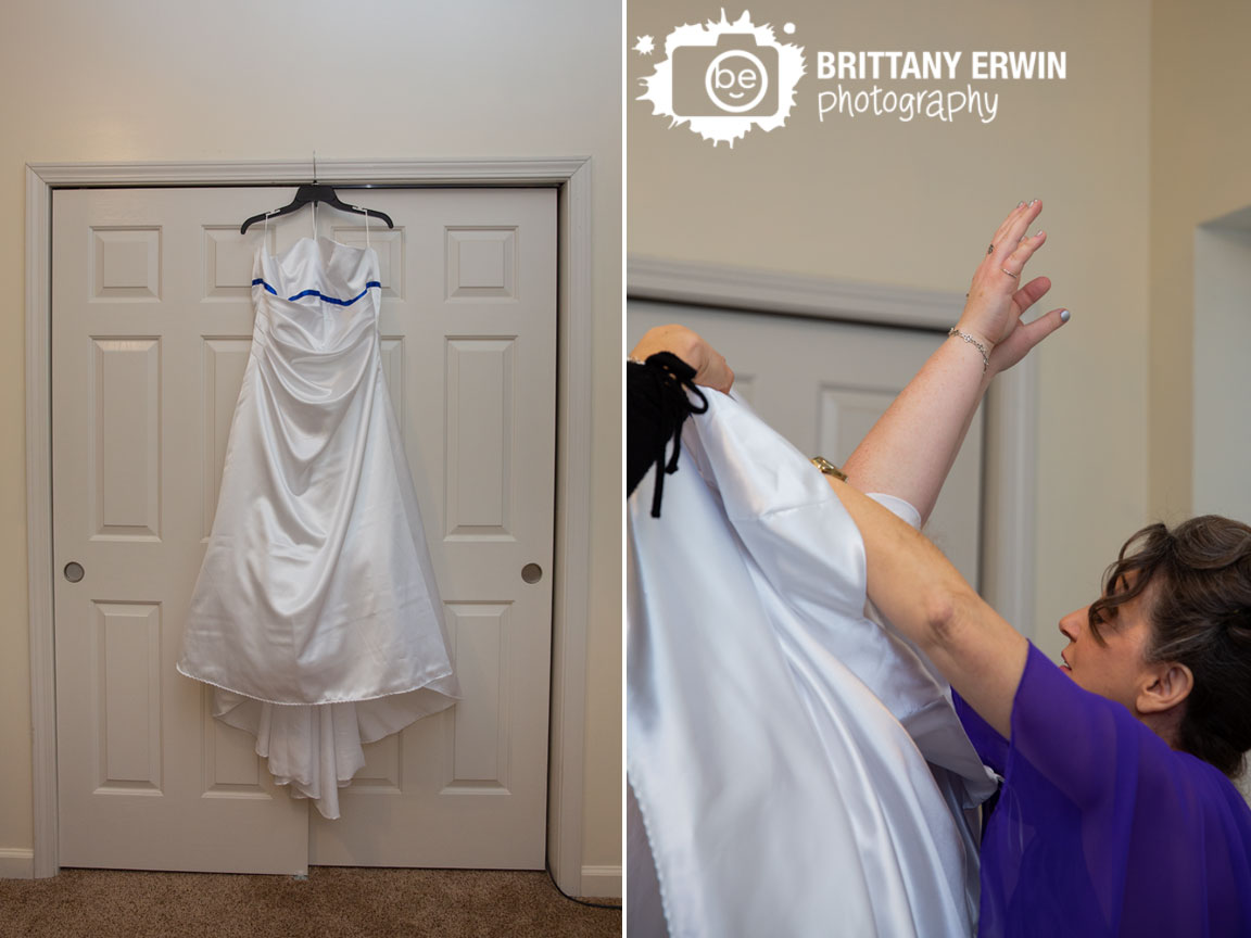 Indianapolis-wedding-photographer-dress-hanging-in-front-of-white-doors-bride-arms-up.jpg