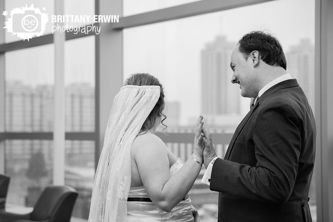 Indianapolis-wedding-photographer-bride-and-groom-hold-hands-after-first-look.jpg