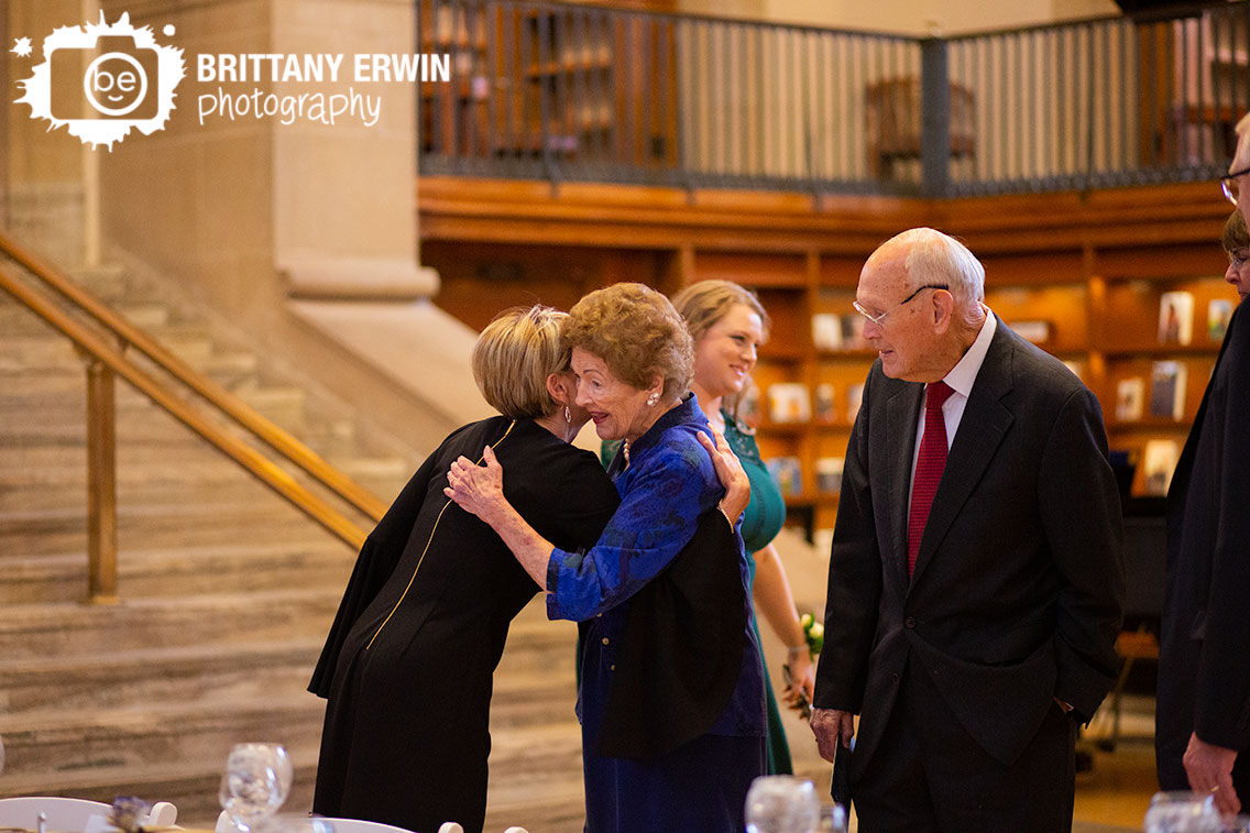 Indianapolis-wedding-photographer-guests-at-ceremony-hug-greet.jpg