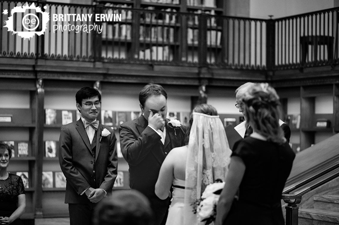 Indianapolis-central-library-wedding-ceremony-groom-wiping-eyes-emotional-couple.jpg