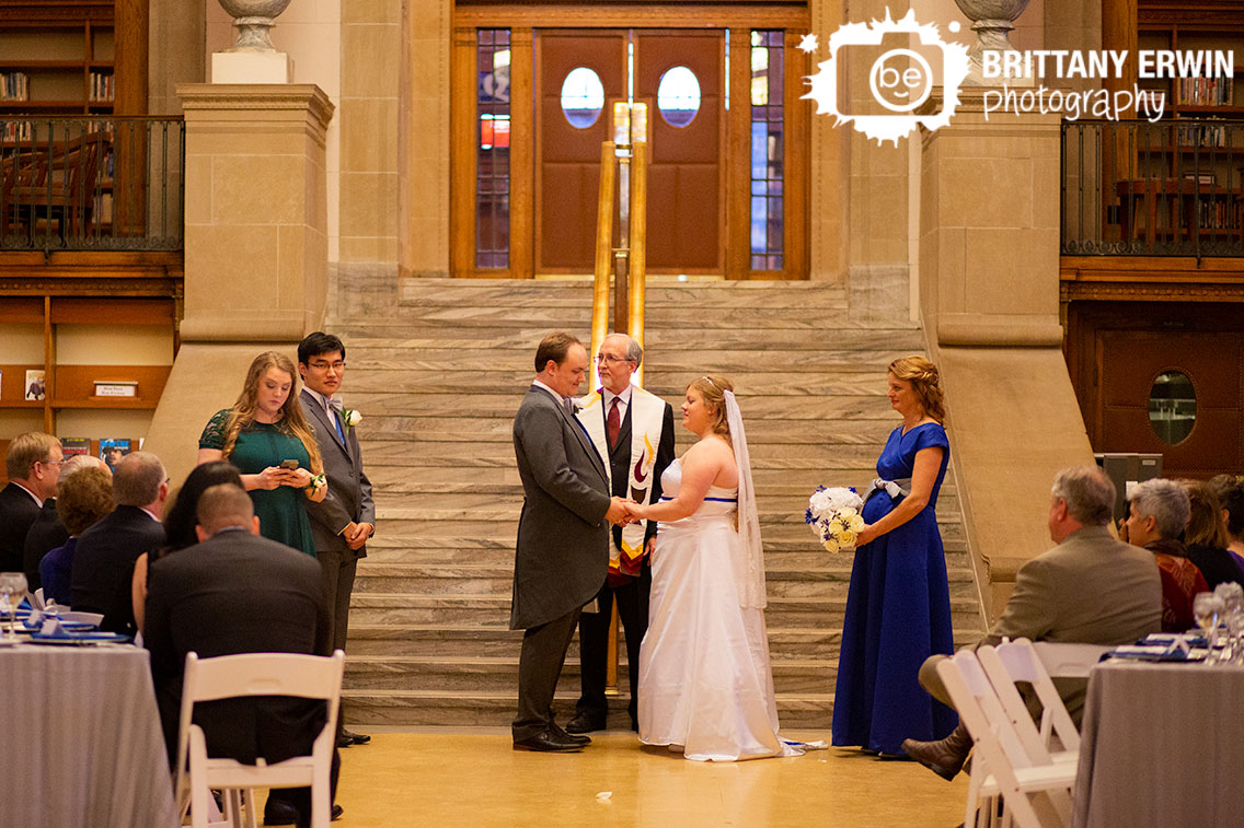 Indianapolis-wedding-photographer-central-library-sister-of-groom-reading-at-altar.jpg
