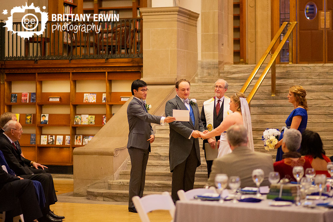 Indianapolis-central-library-downtown-Indy-wedding-ceremony-photography-groom-reading-vows.jpg
