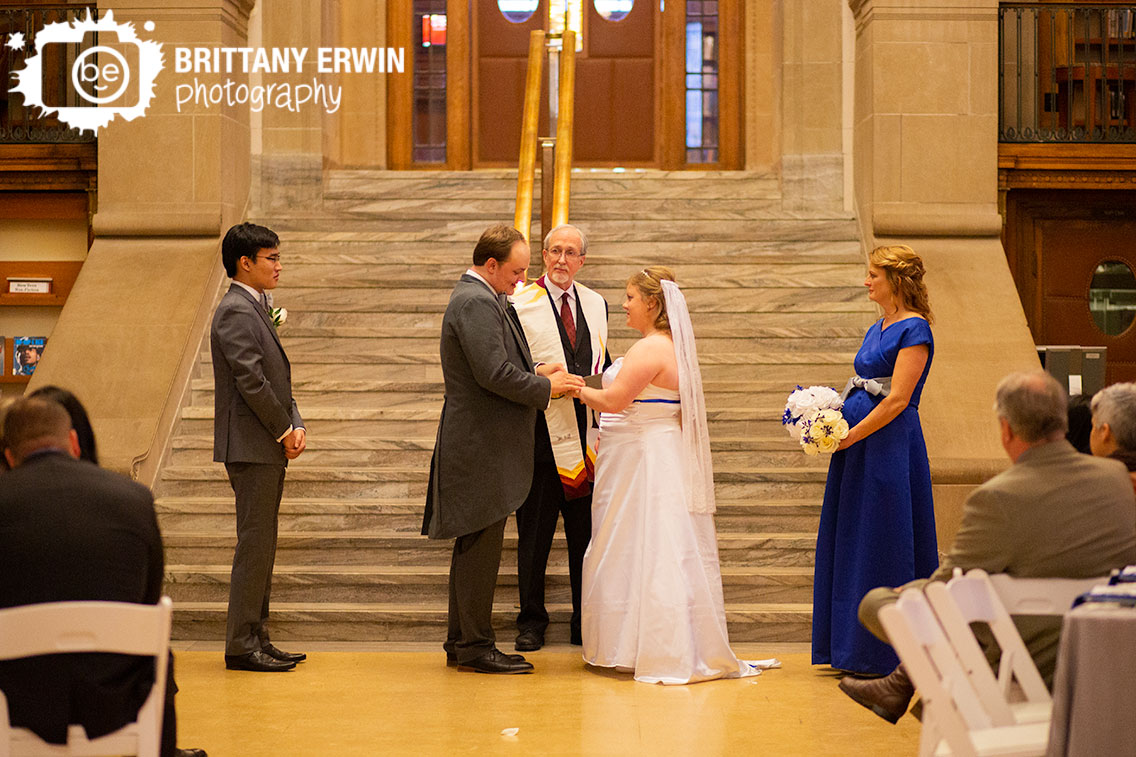 Indianapolis-wedding-photographer-central-library-ceremony-groom-ring-exchange-with-bride.jpg