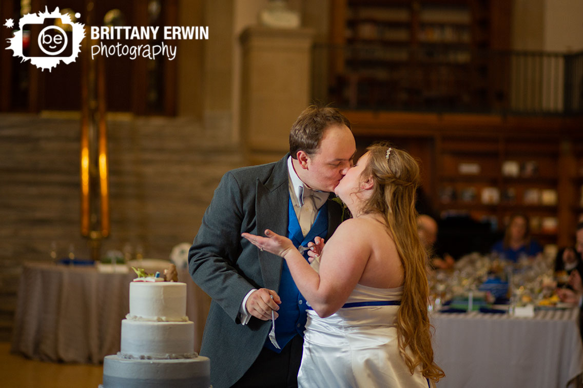 Indianapolis-central-library-wedding-reception-photographer-couple-kiss-after-cake-cutting.jpg