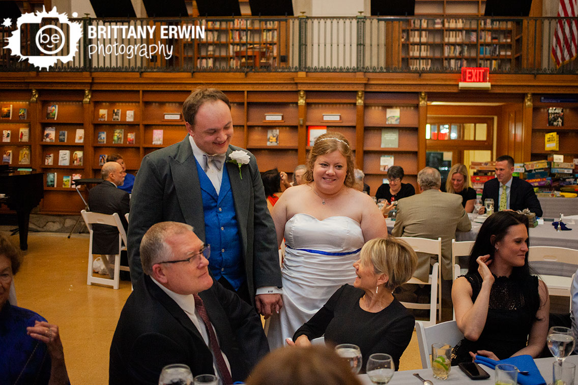 Indianapolis-wedding-photographer-couple-visit-tables-at-central-library-reception.jpg