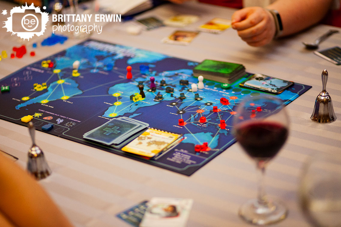 Indianapolis-wedding-photographer-central-library-nerdy-reception-playing-board-game-pandemic.jpg