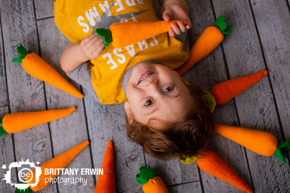 Indianapolis-photographer-toddler-boy-on-floor-with-carrots-easter-bunny.jpg