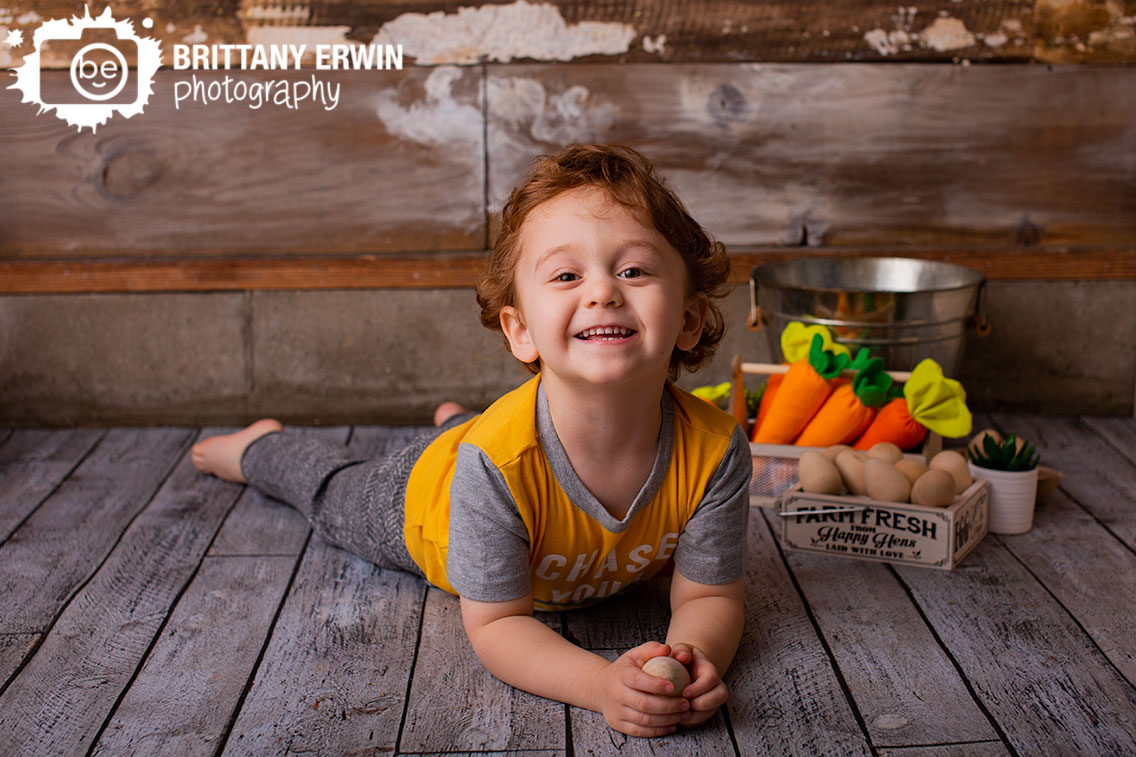 Indianapolis-portrait-studio-photographer-toddler-boy-silly-on-floor-easter-spring-session.jpg